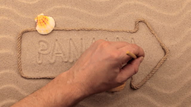 Panama inscription written by hand on the sand, in the pointer made from rope. video