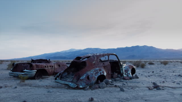 Panamint Valley Sunset with rusted cars - Time lapse A time lapse of sunset in the Panamint Valley in Death Valley National Park, California. Old rusted cars are in the foreground, the Argus Range in the background. mojave desert stock videos & royalty-free footage