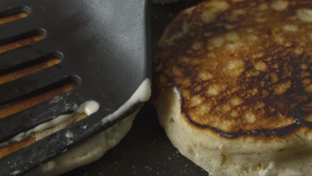 Pancakes being cooked and turned around with spatula video