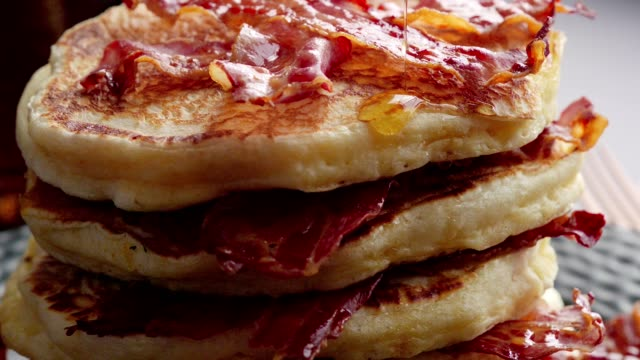Pancakes with Crispy Bacon and Maple Syrup Pancakes with Crispy Bacon and Maple Syrup bacon stock videos & royalty-free footage