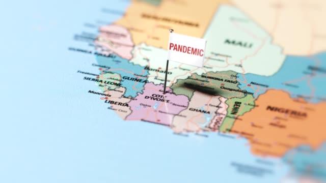 пандемический флаг на кот-д'ивуаре. - линия экватора стоковые видео и кадры b-roll