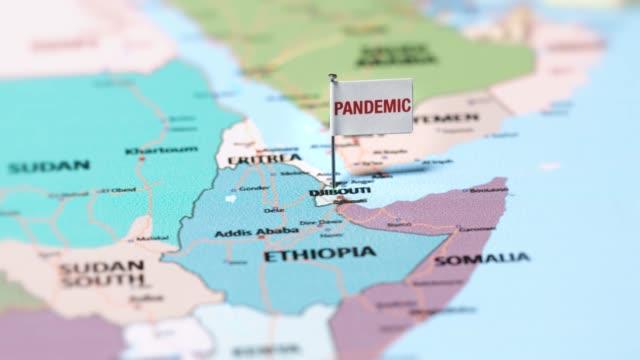 пандемический флаг на диджибути. - линия экватора стоковые видео и кадры b-roll