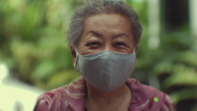 Pandemic Season : Asian senior woman in a protective mask. Positive Mood east asian culture stock videos & royalty-free footage