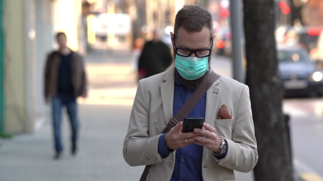 covid-19 pandemic - businessman covid mask video stock e b–roll