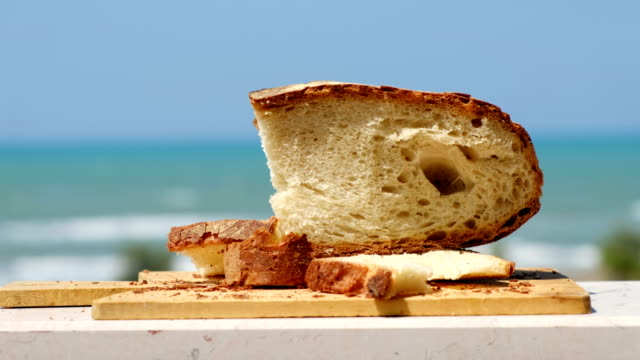 pane pugliese, a traditional bread of south italy food tradition - lecce video stock e b–roll