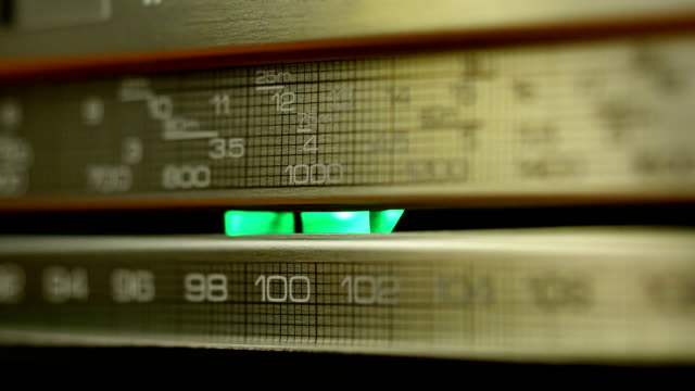 Panel of retro radio receiver illuminated by lights and shadow video