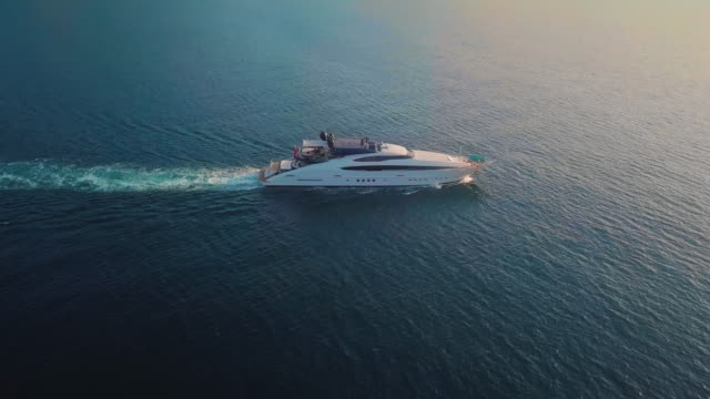 A Panned View of a Yacht Sailing at the Coast of Amalfi A view of a yacht sailing off the coast of Amalif on a sunny morning. yacht stock videos & royalty-free footage