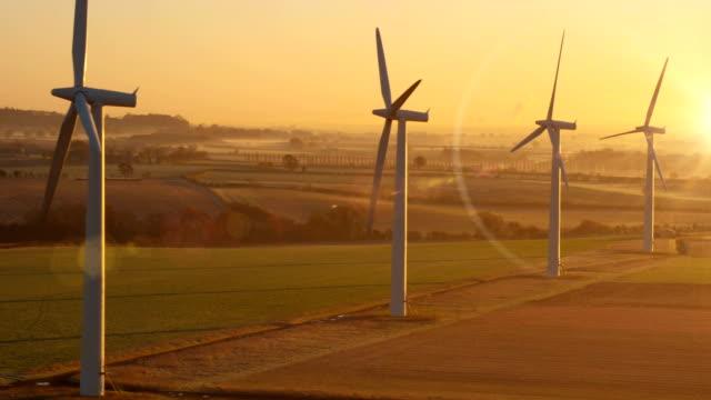 Panning across wind turbines video