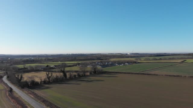 Panning aerial footage overlooking farmers fields video