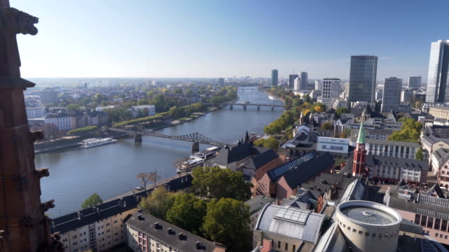 panning aerial view: main river of cityscape of frankfurt, germany in morning - francoforte sul meno video stock e b–roll