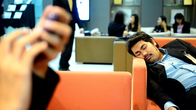 panning : business men are tired and taking a nap video