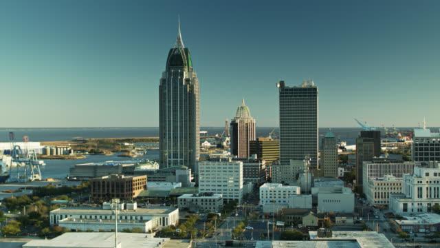 panning drone shot of port and downtown skyline of mobile, alabama - alabama filmów i materiałów b-roll