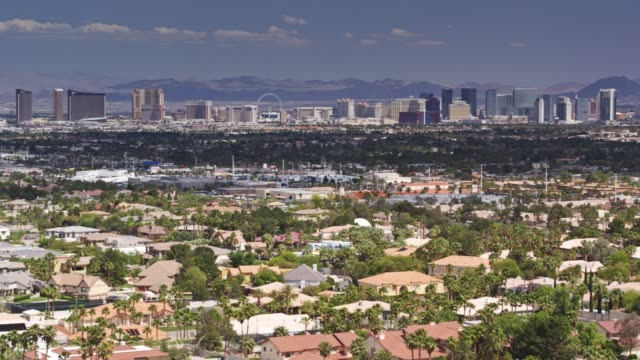 panning drone shot of the las vegas suburbs with the strip - nevada video stock e b–roll