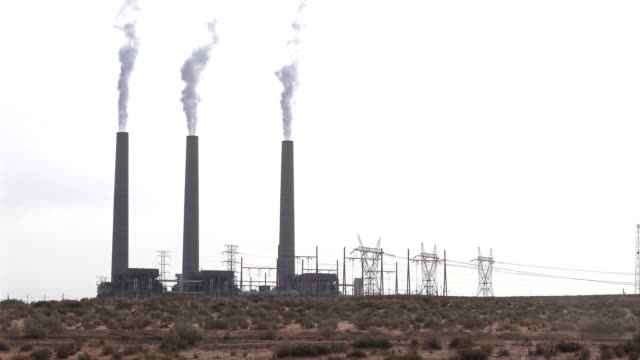 Panning Focus in shot Smoke from Chimney tower of Thermal coal Power plant in Page Arizona USA