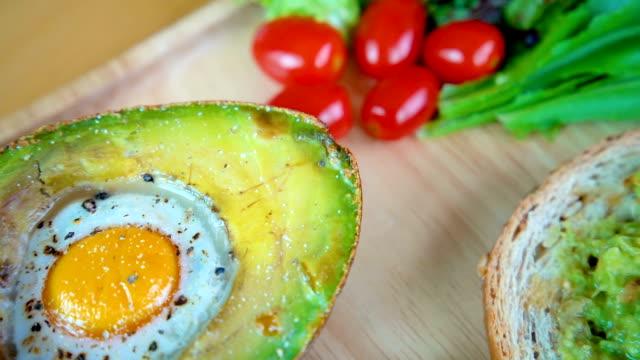 4K panning healthy breakfast, avocado jam sandwich and salad. video