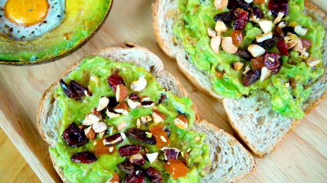 4K panning healthy breakfast, avocado jam sandwish and salad. video