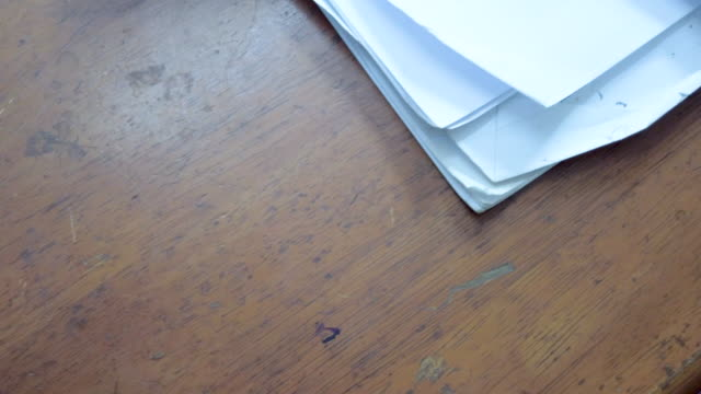 Panning , High angle view .Document on table .