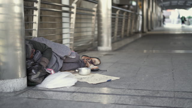panning: homeless sleeping on the footpath. - homelessness stock videos & royalty-free footage