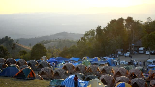 panning : many tents are camping at dawn panning : many tents are camping at dawn daylight savings stock videos & royalty-free footage