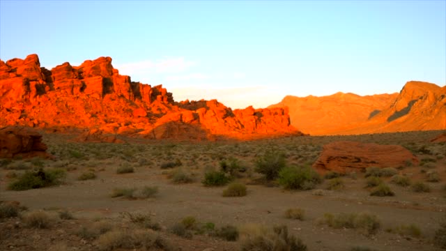 panning of majestic red rock landscape in the desert at sunset - red rock canyon national conservation area video stock e b–roll