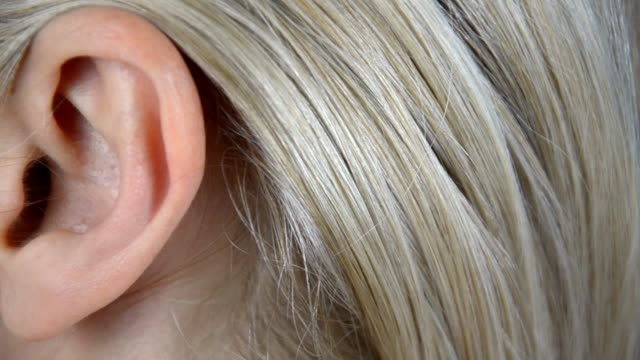 Panning over a woman's ear Extreme closeup footage of a woman's ear. Panning camera ear stock videos & royalty-free footage