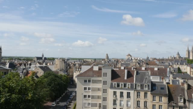 Panning over city of Caen located in northern French region Normandy 4K Panning over city of Caen located in northern French region Normandy 4K 3840X2160 UltraHD footage - Cityscape of Calvados capital Caen in France 4K 2160p UHD pan video caen stock videos & royalty-free footage