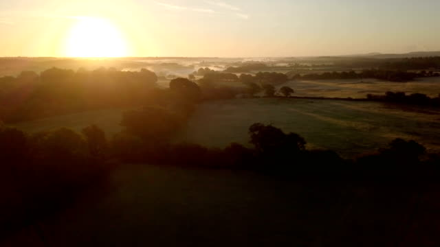 Panning over English countryside at dawn