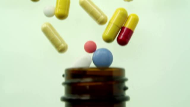 Panning over spilled bottle pills medicine concept video
