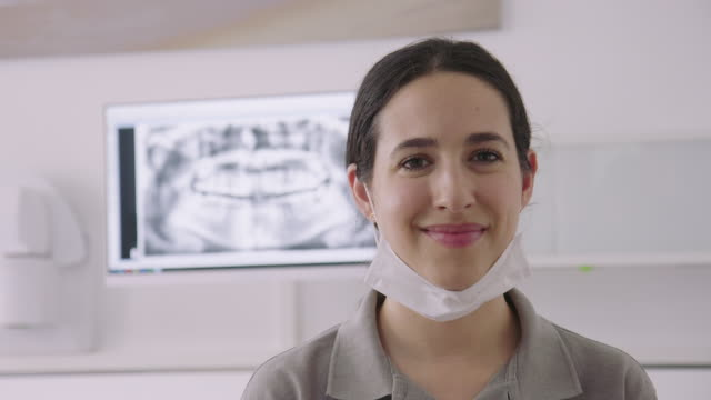 panning portrait of confident dental assistant - dentist stock videos & royalty-free footage