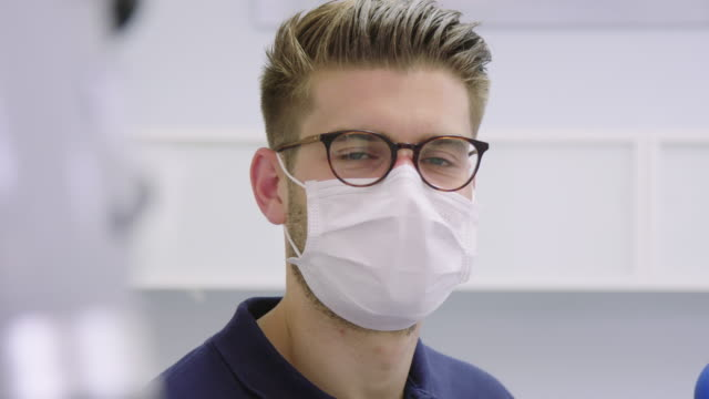 panning portrait of confident dentist at hospital - face mask stock videos & royalty-free footage