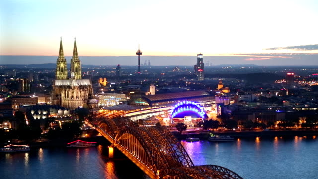 Panning Shot: Aerial Cologne Cathedral Hohenzollern Bridge at dusk Germany video
