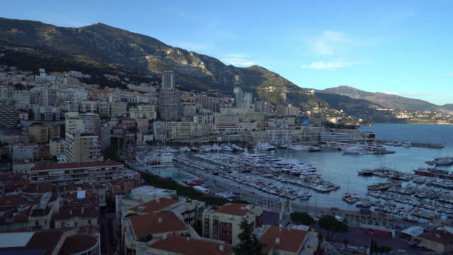 panning shot Aerial Monaco Monte Carlo harbour french riviera sunset 4K panning shot Aerial Monaco Monte Carlo harbour french riviera sunset, Apple ProRes 422 (HQ) 3840x2160 Format monte carlo stock videos & royalty-free footage