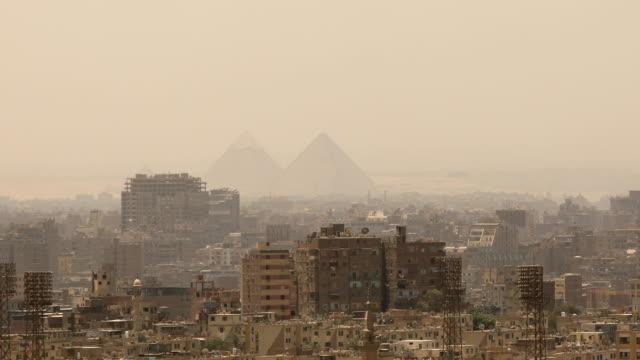 panning shot cityscape of cairo in egypt - египет стоковые видео и кадры b-roll