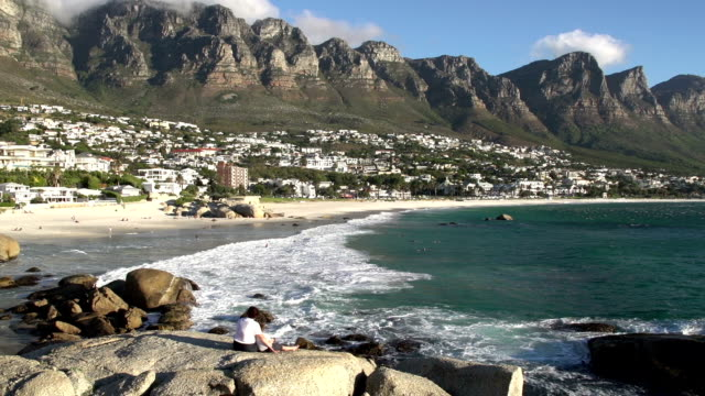 Panning shot of Camps Bay beach with mother and child enjoying the view, Panning shot of Camps Bay beach with mother and child enjoying the view, Cape Town,South Africa table mountain national park stock videos & royalty-free footage