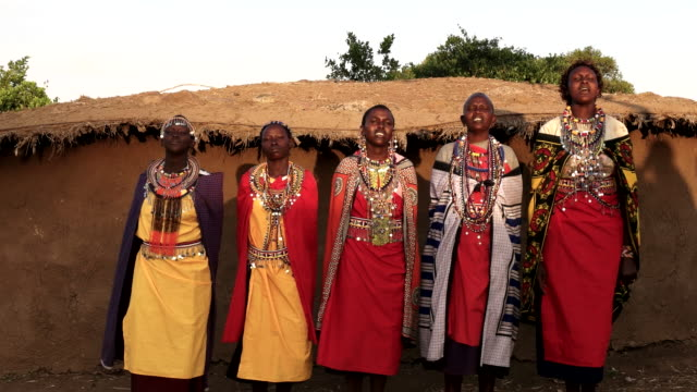 panning shot of five maasai women singing in a village panning shot of five maasai women singing in a village near mara, kenya dress stock videos & royalty-free footage