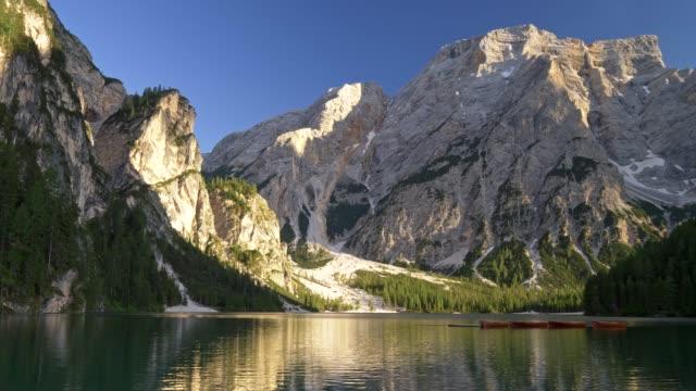 Panning shot of Lake Braies (Lago di Braies) in Dolomites mountains, Italy.