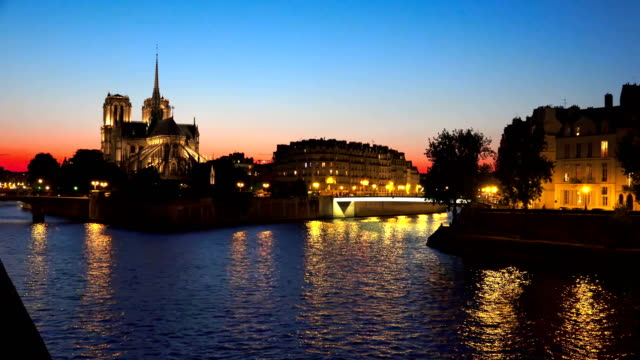 Panning shot of Notre Dame cathedral in Paris at twilight, sunset Panning shot of Notre Dame cathedral in Paris at twilight, sunset european culture stock videos & royalty-free footage