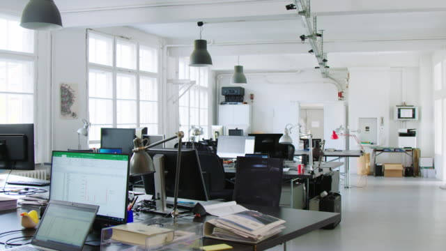 panning shot of open plan office - space video stock e b–roll