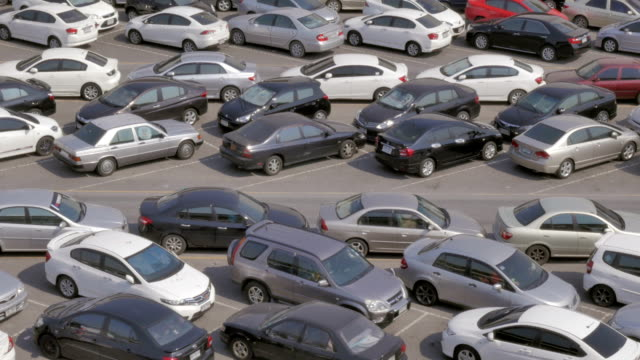 Panning shot of Parking lot full of cars video