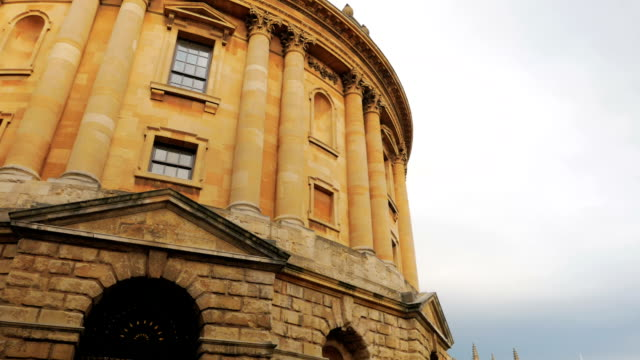 Panning shot revealing the large complex of college buildings in Oxford, UK video