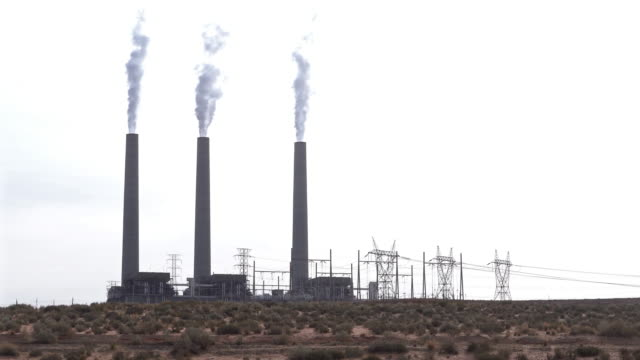 Panning shot Smoke from Chimney tower of Thermal coal Power plant in Page Arizona USA