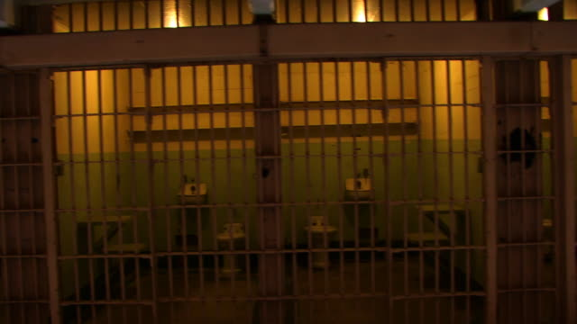 Panning Through Cells HD Panning through Cells HD prison bars stock videos & royalty-free footage