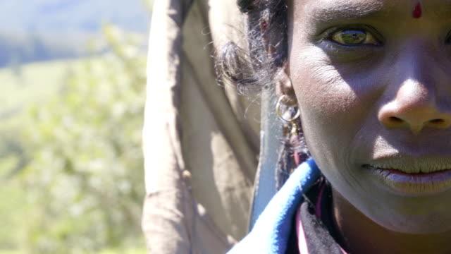 Panning to right: Sri Lankan woman tea picker portrait video