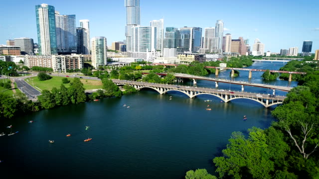 Panning up from Kayakers and Bridges to the Austin Texas 2019 Skyline Cityscape with the Tallest building and no cranes