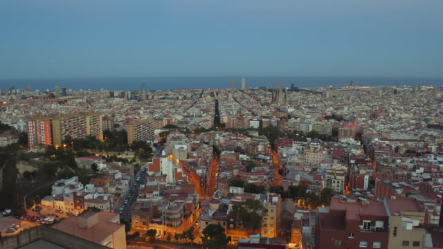 Panning video of Barcelona Skyline at dusk Panning video of Barcelona Skyline at dusk, Catalonia, Spain post modern architecture stock videos & royalty-free footage