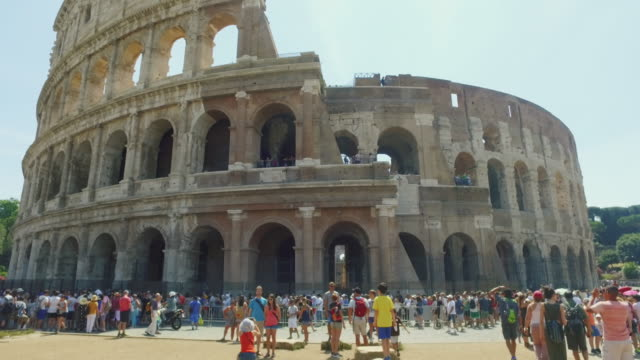 Panning video of the Coliseum of Rome, crowded with tourists video