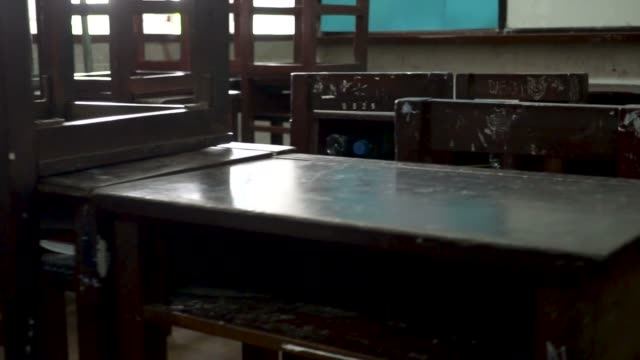 Panning video shot of old classroom towards the whiteboard in public school in Thailand