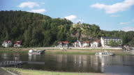 istock panning view from small Village around Kurort Rathen railway station on a curve of Elbe river to see small Village around the curve of Elbe river with boat port in Germany in a weekend. 1286479223