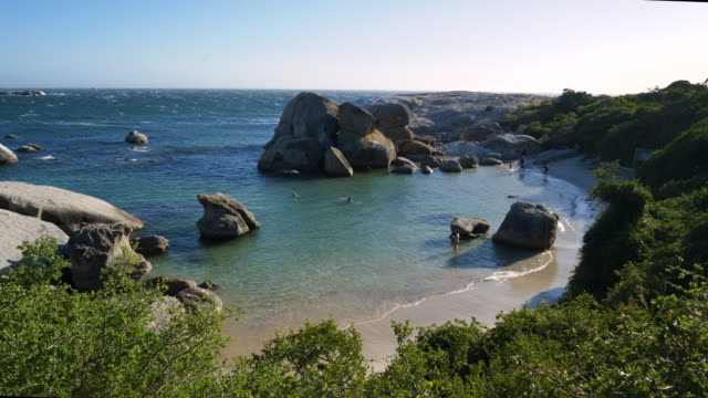 4K panning view of people enjoying a swim at Boulders beach, Cape Town 4K panning view of people enjoying a swim at Boulders beach, Cape Town western cape province stock videos & royalty-free footage