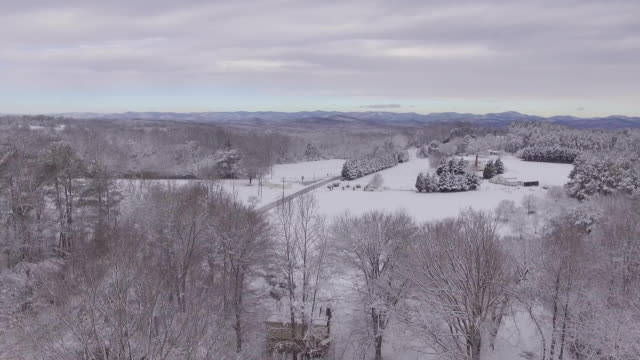 panning view of valley panning view of snow covered valley and road. dow jones industrial average stock videos & royalty-free footage